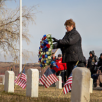 City councilor and U.S. Navy veteran Fran Palochak places a wreath at the Hill Crest Cemetery Veterans Plot Monday morning during the wreath laying ceremony at the unknown soldiers graves for Veterans Day.