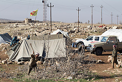 © Licensed to London News Pictures. 11/12/2014. Sinjar Mountains, Iraq.<br /> <br /> Although a well publicised exodus of Yazidi refugees took place from Mount Sinjar in August 2014 many still remain on top of the 75 km long ridge-line, with estimates varying from 2000-8000 people, after a corridor kept open by Syrian-Kurdish YPG fighters collapsed during an Islamic State offensive. The mountain is now surrounded on all sides with winter closing in, the only chance of escape or supply being by Iraqi Air Force helicopters. Photo credit: Matt Cetti-Roberts/LNP