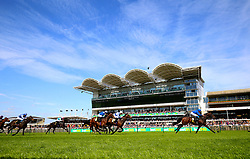 Aurum ridden by jockey William Buick (right) on his way to winning the Alex Scott Maiden Stakes during day one of The Bet365 Craven Meeting at Newmarket Racecourse, Newmarket.