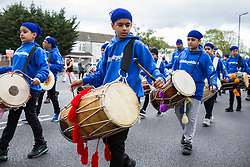 Slough, UK. 28th April 2019. Sikh dhol drummers from Ministry of Dhol take part in the Vaisakhi Nagar Kirtan procession. Vaisakhi is the holiest day in the Sikh calendar, a harvest festival marking the creation of the community of initiated Sikhs known as the Khalsa.