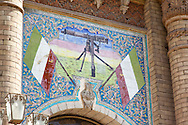 Iran , Tehran  Post office museum, the iranian flag and a machine gun on the main door entrance/ Teheran