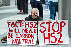 """Stop HS2 campaigner Scott Breen takes part in outreach activities in front of a HS2 Routewide Roadshow at Kings Cross Square on 5th August 2021 in London, United Kingdom. There have been increasing doubts regarding the viability of the northern section of the HS2 high-speed rail link since a recent report published by the Infrastructure and Projects Authority gave Phase 2b the lowest 'red' rating, indicating that successful delivery of the scheme """"appears to be unachievable""""."""