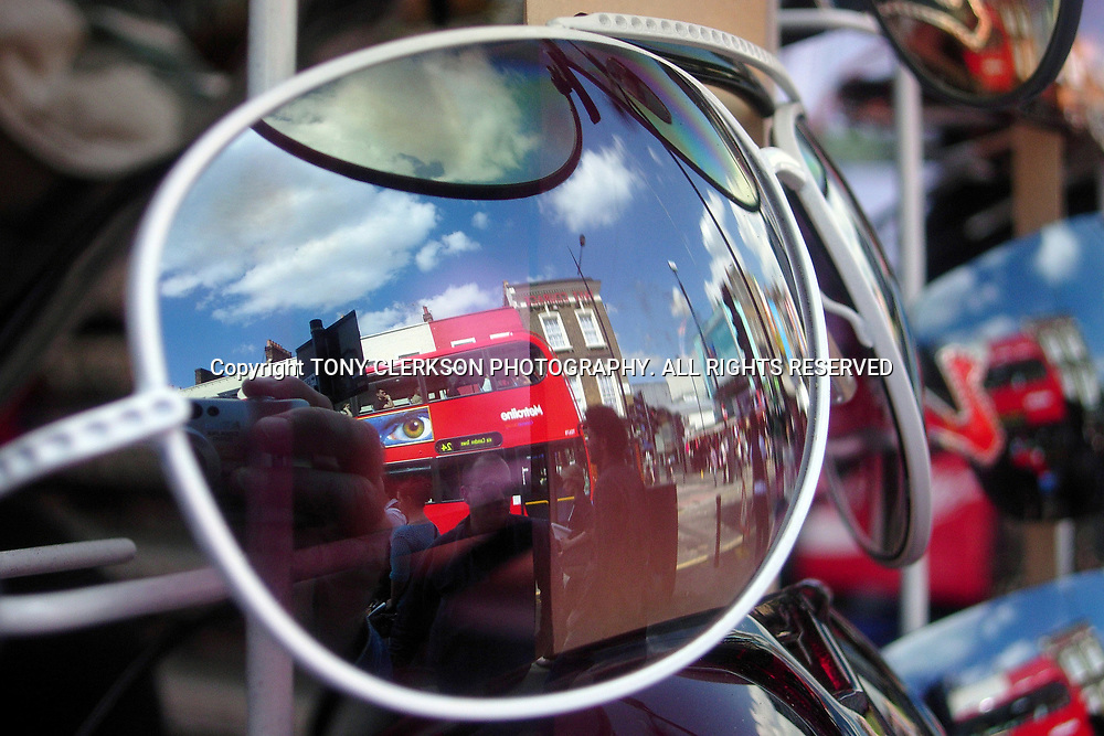 An eye on a bus advert appears to look through a pair of sunglasses on sale at London's Camden Market.