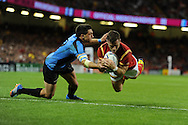 Gareth Davies of Wales dives over to score his 2nd half try. Rugby World Cup 2015 pool A match, Wales v Uruguay at the Millennium Stadium in Cardiff, South Wales  on Sunday 20th September 2015.<br /> pic by  Andrew Orchard, Andrew Orchard sports photography.