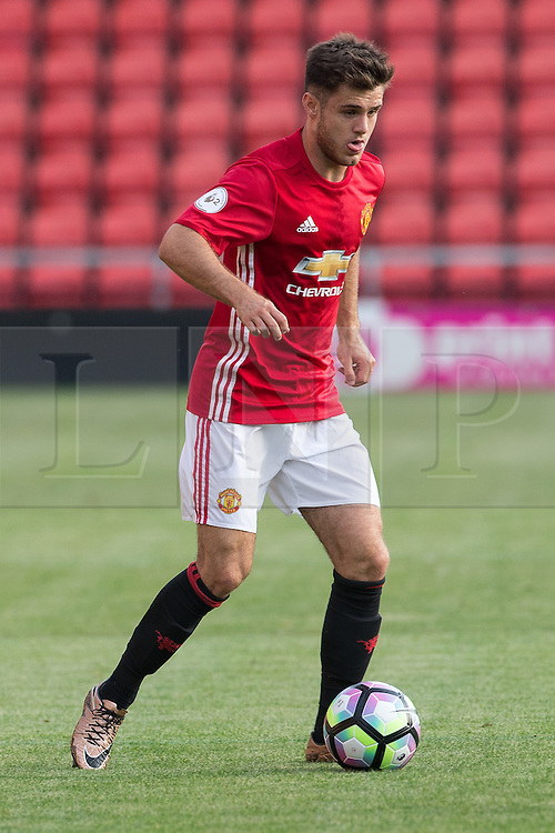 © Licensed to London News Pictures . 15/08/2016 . Leigh , UK . JOE RILEY on the ball . Manchester United vs Leicester City reserves at Leigh Sports Village Stadium . Photo credit : Joel Goodman/LNP