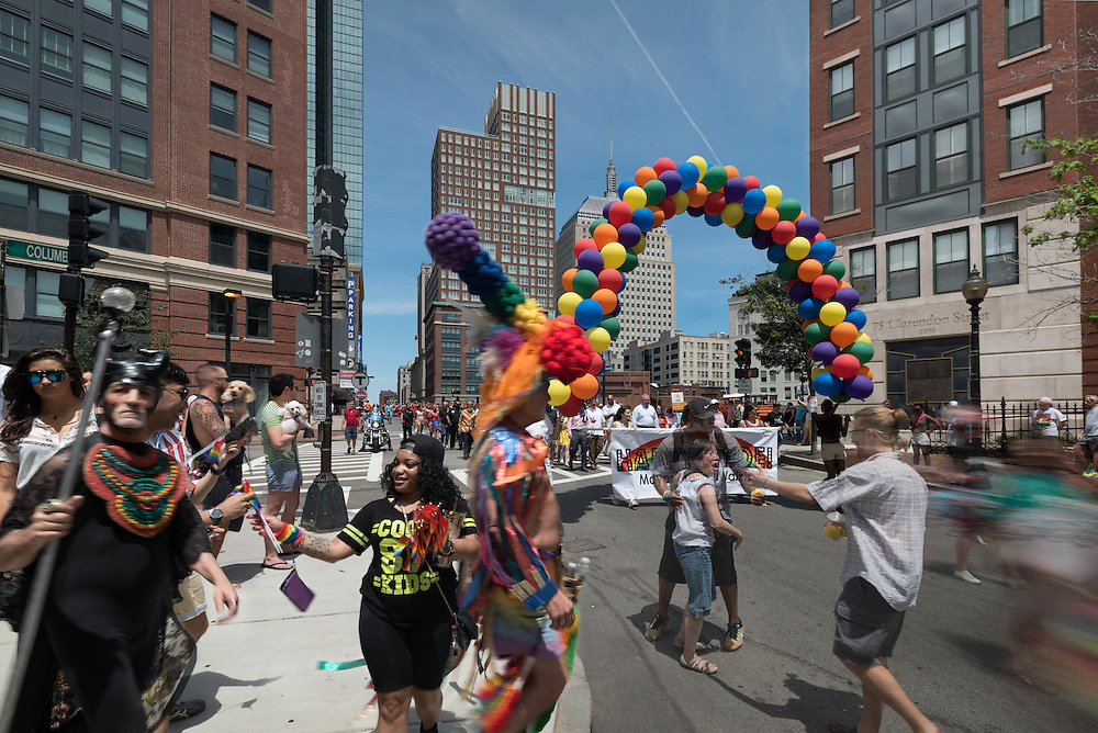 Taken Saturday, June 13th, 2015 from 11:59AM-12:55PM. Found and © photo by Mike Ritter.<br /> <br /> The Boston Gay Pride Parade starts on Boylston Street and comes past this point on Clarendon Street shortly later passing through the South End then the Public Garden and Beacon Hill before finishing in Government Center. That's Mayor Marty Walsh's contingent with the arch of balloons. He has been a long standing proponent for gay rights starting when he was a State Rep and is a crowd favorite. There were so many lovely hugs between bystanders and marchers. I was happy to get the reunion in progress in the street which stood in for all the others I saw. And, of course, there were great costumes. Massachusetts was the first state to embrace same sex marriage in 2004; and on June 26th, 2015, not long after this time collage was taken, The Supreme Court ruled in favor of making same sex marriage legal across on the country.