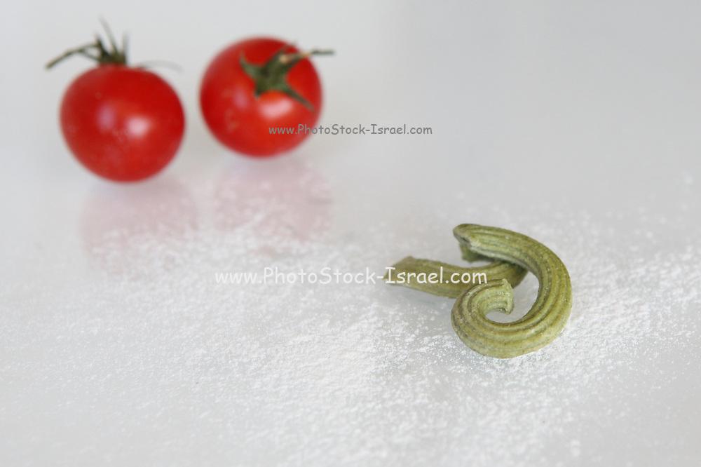 Fresh spinach Macaroni on white