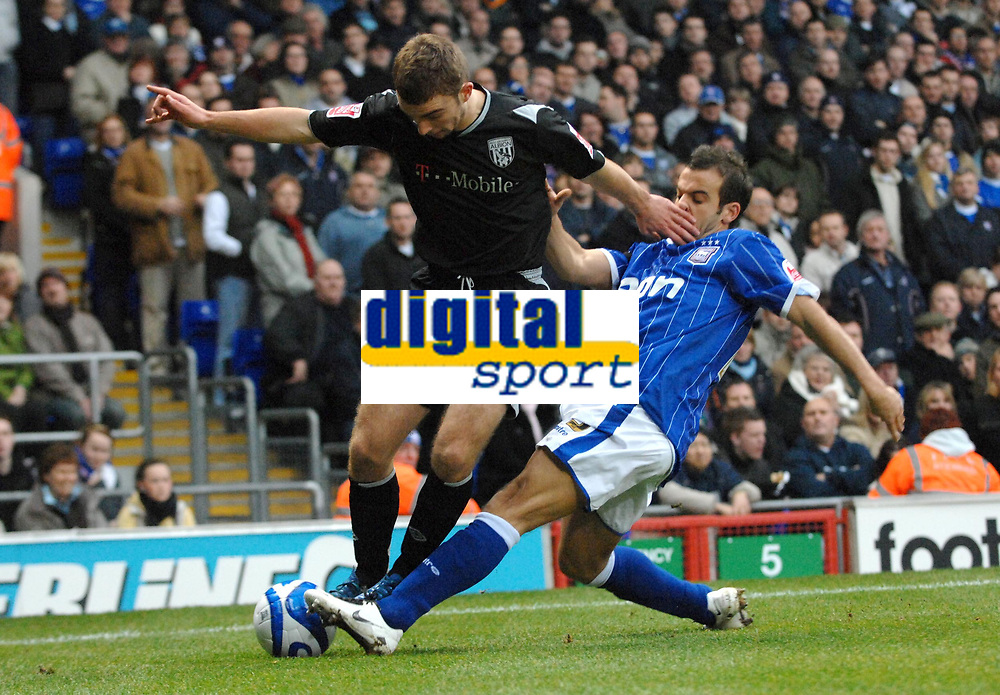 Photo: Ashley Pickering/Sportsbeat Images.<br /> Ipswich Town v West Bromwich Albion. Coca Cola Championship. 01/01/2008.<br /> James Morrison of WBA (L) is tackled by Sito Castro of Ipswich