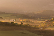 View of hills covered in fog at sunrise, Ronda, Andalusia, Spain