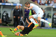 Gylfi Sigurdsson of Swansea city is fouled by David Meyler of Hull city. Premier league match, Swansea city v Hull city at the Liberty Stadium in Swansea, South Wales on Saturday 20th August 2016.<br /> pic by Andrew Orchard, Andrew Orchard sports photography.