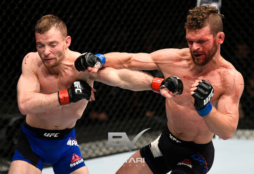 TORONTO, CANADA - DECEMBER 10:  (L-R) Zach Makovsky and Dustin Ortiz trade punches in their flyweight bout during the UFC 206 event inside the Air Canada Centre on December 10, 2016 in Toronto, Ontario, Canada. (Photo by Jeff Bottari/Zuffa LLC/Zuffa LLC via Getty Images)
