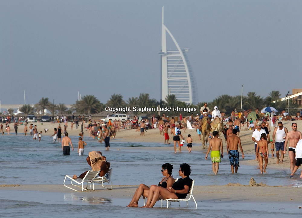 File Photos - Brits likely to risk health this summer - report<br /> A survey by Cancer Research UK and Nivea Sun, embargoed until April 29, suggests that around 4.9m in the UK, or 10% of the population, are likely to risk scorching themselves in strong sun in an attempt to get a tan following recent cold and wet weather. The survey also reveals that 44% of those planning to holiday abroad are doing so because of the UK's poor weather.<br /> Burj Al Arab and beach, Dubai. Photo by: Stephen Lock/i-Images