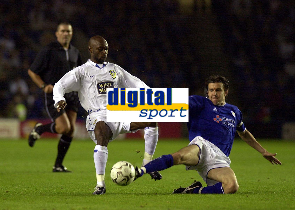 Photo: Greig Cowie.<br /> 15/09/2003.<br /> Barclaycard Premiership. Leicester City v Leeds United, The Walkers Stadium.<br /> Salomon Olembe is tackled by Muzzy Izzet