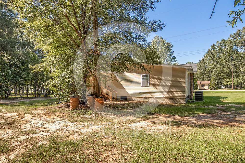 General real estate photos of a house at 319 S Hospital DR, Sandersville, GA. (Paul Abell via Abell Architectural and Real Estate Photography for Victoria Payne)