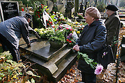 Preparing for All Saints Day. Powazek Cemetery. Warsaw, Poland.