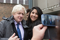 © Licensed to London News Pictures. 09/12/2014. London, UK. The Mayor of London, Boris Johnson poses for a selfie with a player after taking part in a netball match with a team from Ealing, Hammersmith and Fulham College in West London. Photo credit : Vickie Flores/LNP
