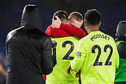 Oli McBurnie (Sheffield United) hugging John Egan (Sheffield United) with Lys Mousset (Sheffield United) looking on following the Premier League match between Brighton and Hove Albion and Sheffield United at the American Express Community Stadium, Brighton and Hove, England on 21 December 2019.