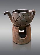 Hittite terra cotta teapot with strainer spout on a charcoa; burner base  . Hittite Period, 1600 - 1200 BC.  Hattusa Boğazkale. Çorum Archaeological Museum, Corum, Turkey .<br />  <br /> If you prefer to buy from our ALAMY STOCK LIBRARY page at https://www.alamy.com/portfolio/paul-williams-funkystock/hittite-art-antiquities.html  - Type Hattusa into the LOWER SEARCH WITHIN GALLERY box. Refine search by adding background colour, place,etc<br /> <br /> Visit our HITTITE PHOTO COLLECTIONS for more photos to download or buy as wall art prints https://funkystock.photoshelter.com/gallery-collection/The-Hittites-Art-Artefacts-Antiquities-Historic-Sites-Pictures-Images-of/C0000NUBSMhSc3Oo