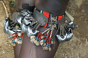 A Hamar woman wears bells on her lower legs to create sound when dancing. Photographed in the Omo River Valley, Ethiopia