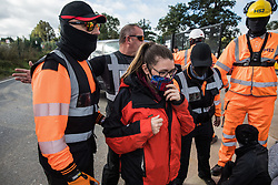 Harefield, UK. 12th September, 2020. Security guards working on behalf of HS2 block environmental activists acting in solidarity with HS2 Rebellion from the road in front of a gate providing access to a site for the HS2 high-speed rail link. Anti-HS2 activists continue to try to prevent or delay works on the controversial £106bn HS2 high-speed rail link in the Colne Valley where thousands of trees have already been felled.