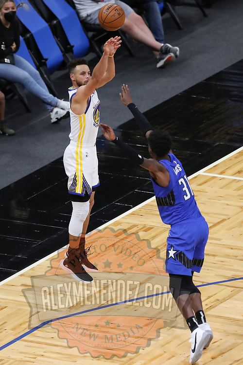 ORLANDO, FL - FEBRUARY 19:  Stephen Curry #30 of the Golden State Warriors plays against the Orlando Magic during the first half at Amway Center on February 19, 2021 in Orlando, Florida. NOTE TO USER: User expressly acknowledges and agrees that, by downloading and or using this photograph, User is consenting to the terms and conditions of the Getty Images License Agreement. (Photo by Alex Menendez/Getty Images)*** Local Caption *** Stephen Curry