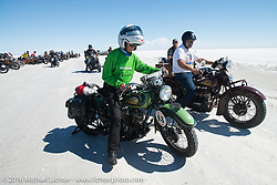 Dottie Mattern riding her 1936 Indian Scout next to Dave Holzerland on his 1935 Indian Four after the Panorama portrait on the Bonneville Salt Flats during stage 12 (299 m) of the Motorcycle Cannonball Cross-Country Endurance Run, which on this day ran from Springville, UT to Elko, NV, USA. Wednesday, September 17, 2014.  Photography ©2014 Michael Lichter.