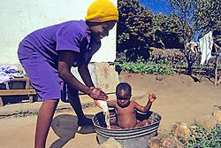 Woman Gives Toddler A Bath