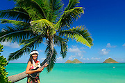 Woman playing ukulele,Mokulua Islands, Lanikai, Kailua, Oahu, Hawaii