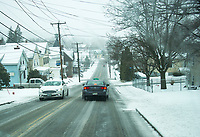 The morning drive greeted Laconia residents with snow and sleet as we received yet another April storm on Monday.  (Karen Bobotas/for the Laconia Daily Sun)