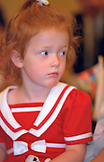 Curious girl age 4 at wedding service.  St Paul  Minnesota USA
