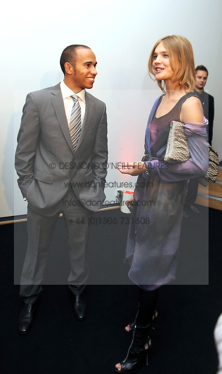 LEWIS HAMILTON and NATALIA VODIANOVA at the TAG Heuer British Formula 1 Party at the Mall Galleries, London on 15th September 2008.