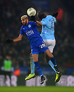 Riyad Mahrez of Leicester cityand Yaya Toure of Manchester City battle for the ball in the air .Carabao Cup quarter final match, Leicester City v Manchester City at the King Power Stadium in Leicester, Leicestershire on Tuesday 19th December 2017.<br /> pic by Bradley Collyer, Andrew Orchard sports photography.