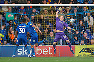 Gillingham attacker Tom Eaves (9) scoring and AFC Wimbledon goalkeeper Aaron Ramsdale (35) diving during the EFL Sky Bet League 1 match between AFC Wimbledon and Gillingham at the Cherry Red Records Stadium, Kingston, England on 23 March 2019.