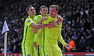 Brighton striker (on loan from Manchester United), James Wilson (21) celebrates his goal with Brighton central midfielder, Beram Kayal (7), and Brighton winger, Jamie Murphy (15) during the Sky Bet Championship match between Derby County and Brighton and Hove Albion at the iPro Stadium, Derby, England on 12 December 2015.