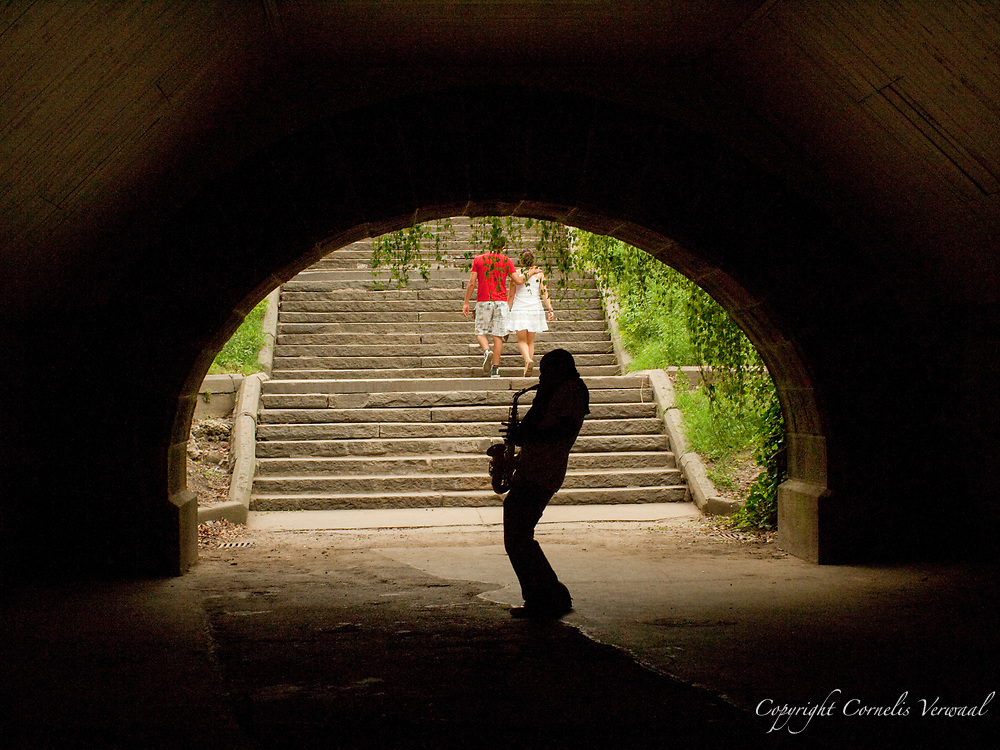 Saxophone player under the Trefoil Arch in Central Park