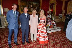 BEN ELLIOT, HRH THE PRINCE OF WALES, THE DUCHESS OF CORNWALL and RUTH POWYS at the Quintessentially Foundation and Elephant Family 's 'Travels to My Elephant' Royal Rickshaw Auction presented by Selfridges and hosted by HRH The Prince of Wales and The Duchess of Cornwall held at Lancaster House, Cleveland Row, St.James's, London on 30th June 2015.
