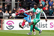 Scunthorpe United defender Jordan Clarke (2) and Plymouth Argyll forward Freddie Ladapo (19) challenge for possession during the EFL Sky Bet League 1 match between Scunthorpe United and Plymouth Argyle at Glanford Park, Scunthorpe, England on 27 October 2018. Pic Mick Atkins