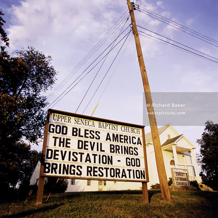"Patriotic Americana - After 9/11. A Baptist church proclamation, Maryland USA. In the week after the September 11th attacks, America sought to express their anger and patriotic unity. A patriotic, Christian message is spelled outside a Baptist church in Cedar Grove, Maryland..""That this nation under God shall have a new birth of freedom, and that government of the people, by the people, for the people shall not perish from the earth."" - By Abraham Lincoln?s Gettysburg Address, November 19th, 1863."
