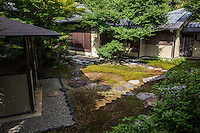 "Tea Garden at Shinnyodo -  Three gardens are to be found at <br /> Shinnyodo Temple.  The first is the Nehan ""Nirvana"" garden and was built in the classic karesansui rock garden style in 1988. It uses the shakkei borrowed landscape technique to include Mt. Hiei in its design. The second garden was designed by Shigemori Chisao - Its modern geometrical style is similar in design to his father renowned landscape architect and garden designer Shigemori Mirei. The third is a small tea garden, with its own tea ceremony hut."