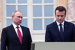 French President Emmanuel Macron and Russian President Vladimir Putin sign the golden book after a visit of an exhibition about Russian emperor Peter the Great at the Grand Trianon after a work meeting at the Versailles Palace near Paris, France, 29 May 2017. This work visit of the Russian President is the first since the Mistral crisis which added to the tensions between France and Russia. Among other subjects the two presidents should talk about the situation in Syria and the constant veto position of the Russian at the UN security council.