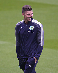 Burnley goalkeeper Nick Pope inspects the pitch