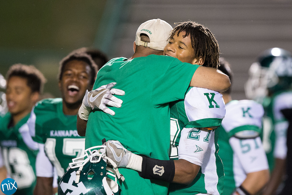 Nakohr Wise (27) of the A.L. Brown Wonders gets a hug following the win over the Vance Cougars at A.L. Brown High School on September 30, 2016 in Kannapolis, North Carolina.  The Wonders defeated the Cougars 24-21.  (Brian Westerholt/Special to the Tribune)