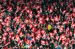 Switzerland fans and flags in the stands during the FIFA World Cup Qualifying second leg match at St Jakob Park, Basel.