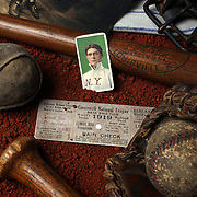 A collage of Antique Vintage Baseball Memorabilia and Collectables including baseballs, wooden baseball bats, hat, catchers mask, used ticket stub, baseball card, signed photograph and baseball shirt. 7th June 2012. Photo Tim Clayton