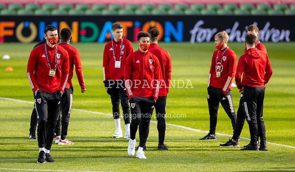 DUBLIN, REPUBLIC OF IRELAND - Sunday, October 11, 2020: Wales' Kieffer Moore (L) and Ethan Ampadu (R), wearing face masks, on the pitch before the UEFA Nations League Group Stage League B Group 4 match between Republic of Ireland and Wales at the Aviva Stadium. The game ended in a 0-0 draw. (Pic by David Rawcliffe/Propaganda)