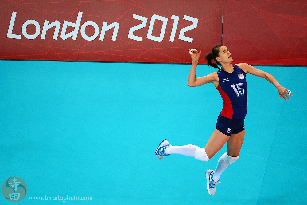 Aug 7, 2012; London, United Kingdom; USA weak-side hitter Logan Tom (15) serves the ball in the women's indoor volleyball quarterfinal match against the Dominican Republic during the London 2012 Olympic Games at Earls Court. USA defeated the Dominican Republic 25-14, 25-21, 25-22.
