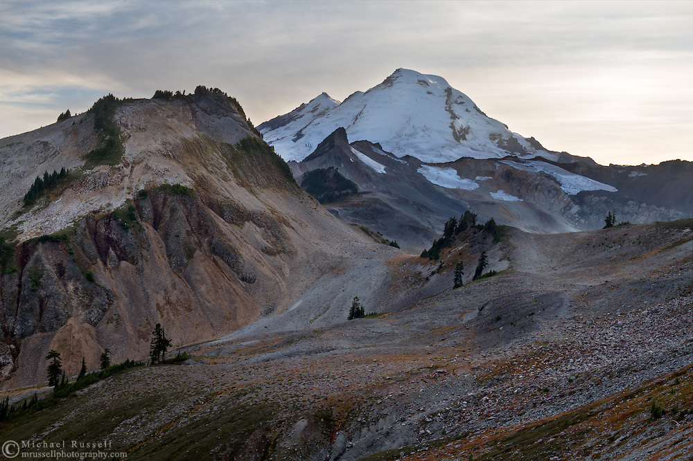 Happy Bunny Butte, Coleman Pinnacle and Mount Baker (L to R) in early October. The 2014/2015 winter had very little snow, so there is likely less snow/ice here than a typical October day. Photographed while hiking the Chain Lakes Trail in the Mount Baker Wilderness, Washington State, USA.