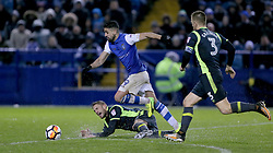 Carlisle united's Danny Grainger tackles Sheffield Wednesday's Marco Matias