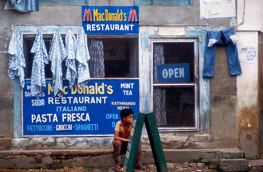 Not a real McDonald's in Kathmandu, Nepal, this eatery catering to travelers was owned by a guy from San Francisco. He and his Nepali partner served Italian food. This knock-off or counterfeiting of the McDonald's brand (albeit with a slightly different spelling) exemplifies globalization and the penetrating power of American brand names and corporate culture even in this once-remote Himalayan Shangri-la.
