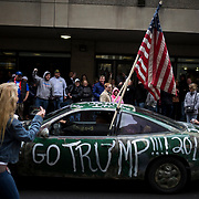 """Attendees are seen here before a campaign event for Donald Trump, president and chief executive of Trump Organization Inc. and 2016 Republican presidential candidate, not pictured, in Albany, New York, U.S., on Monday, April 11, 2016. Trump's new convention manager accused Ted Cruz's campaign of using """"Gestapo tactics"""" after the Texas senator swept the party's convention-delegate selection process in Colorado. Photographer: John Taggart/Bloomberg"""
